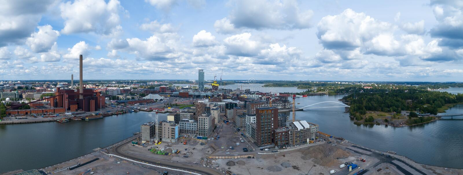 Aerial panorama of new modern buildings under construction in Helsinki city at summer. Beautiful blue sky with clouds. Sompasaari stock image