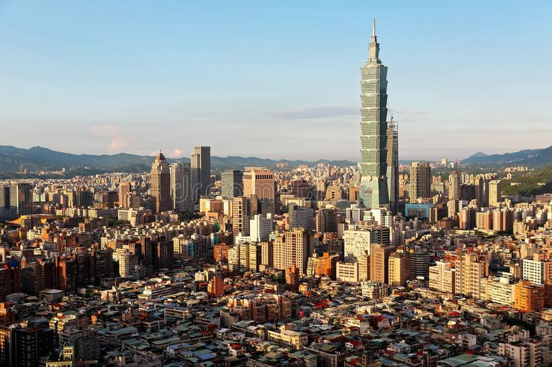 Aerial panorama over Downtown Taipei, capital city of Taiwan with view of prominent Taipei 101 Tower amid skyscrapers stock images
