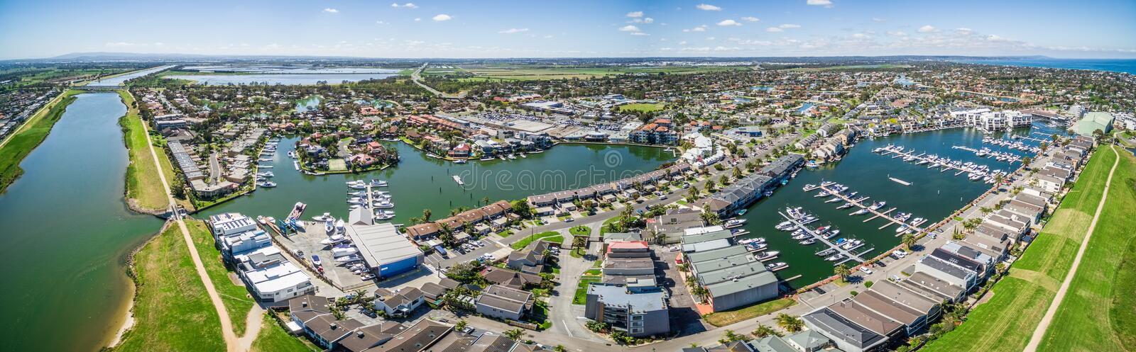 Aerial panorama of Patterson Lakes suburb and river, Melbourne,. Aerial panorama of Patterson River and Patterson Lakes suburb on bright sunny day. Houses nested stock photography