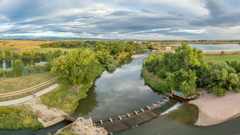 Aerial panorama of Poudre River. Aerial panorama of the Cache la Poudre River with diversion dams and bike trail - Poudre River Trail stock images