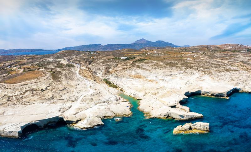 Aerial panorama of the Sarakiniko beach and landscape on the island of Milos, Greece. With volcanic chalk rock formations and blue sea royalty free stock images