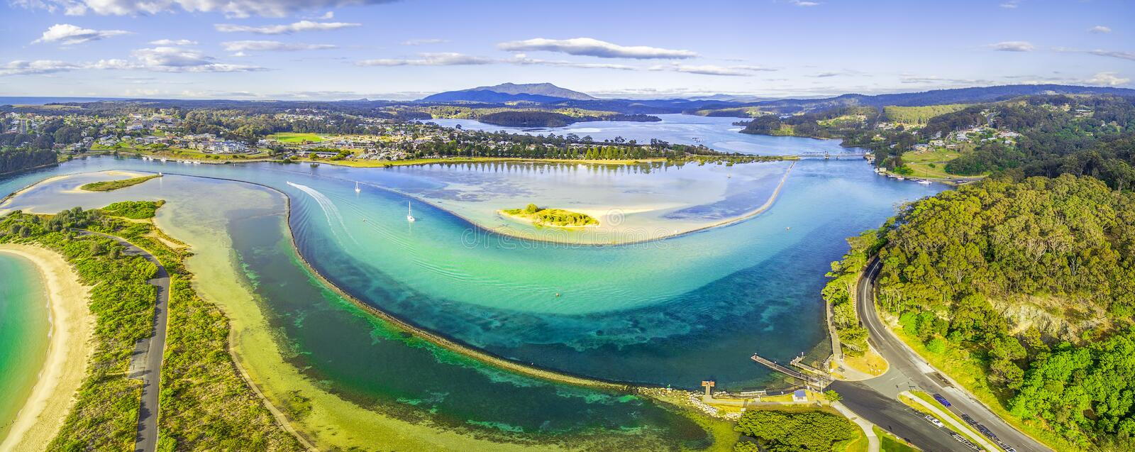 Aerial panorama of shallow ocean water and coastline. Narooma, NSW, Australia. Aerial panorama of shallow ocean water and coastline. Narooma, NSW, Australia stock images