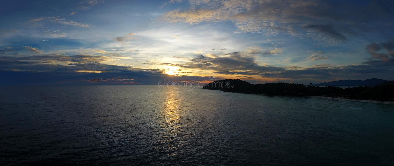 Aerial panorama of sunset sky over sea stock photos