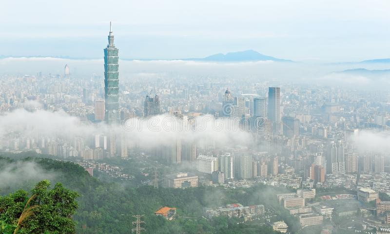 Aerial panorama of Taipei, the capital city of Taiwan, on a foggy morning royalty free stock images