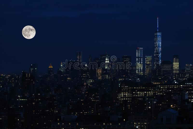 Aerial and panorama view of skyscrapers of New York City, Manhattan. view of night midtown of Manhattan with stars and moon. Aerial and panorama view of stock images