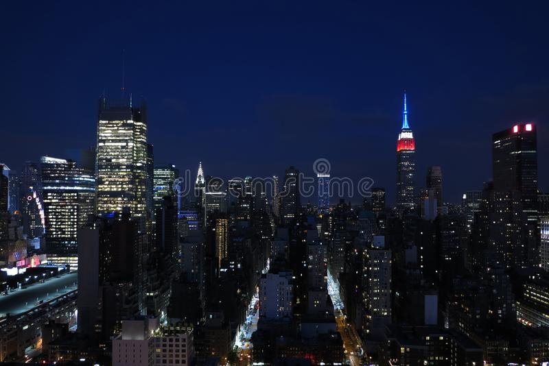 Aerial and panorama view of skyscrapers of New York City, Manhattan. view of night midtown of Manhattan with stars and moon. Aerial and panorama view of royalty free stock photo