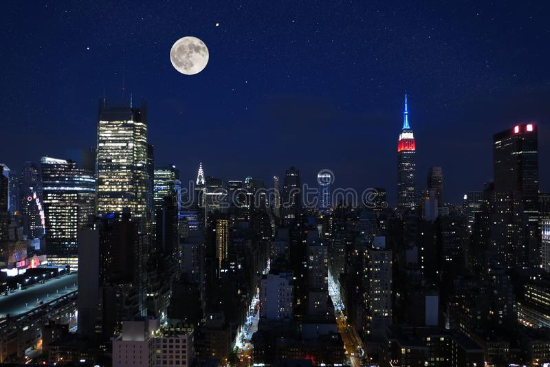 Aerial and panorama view of skyscrapers of New York City, Manhattan. view of night midtown of Manhattan with stars and moon. Aerial and panorama view of royalty free stock image