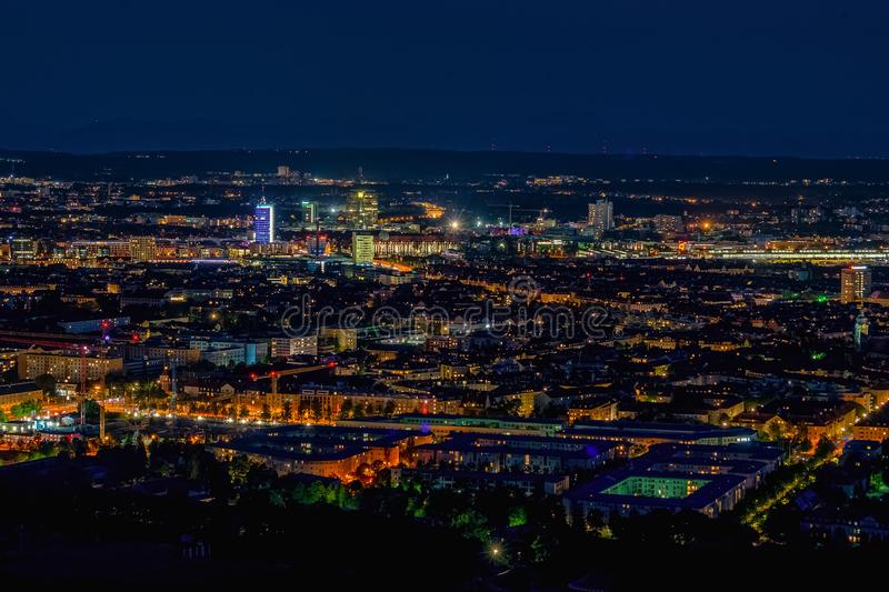 Aerial panoramic cityscape view with bright lights in night Munich stock photography