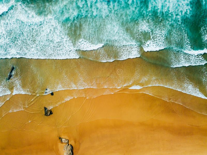 Aerial Panoramic Drone View Of Blue Ocean Waves And Beautiful Sandy Beach royalty free stock image