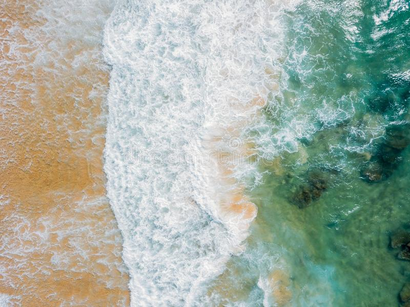 Aerial Panoramic Drone View Of Blue Ocean Waves Crushing On Sandy Beach stock images