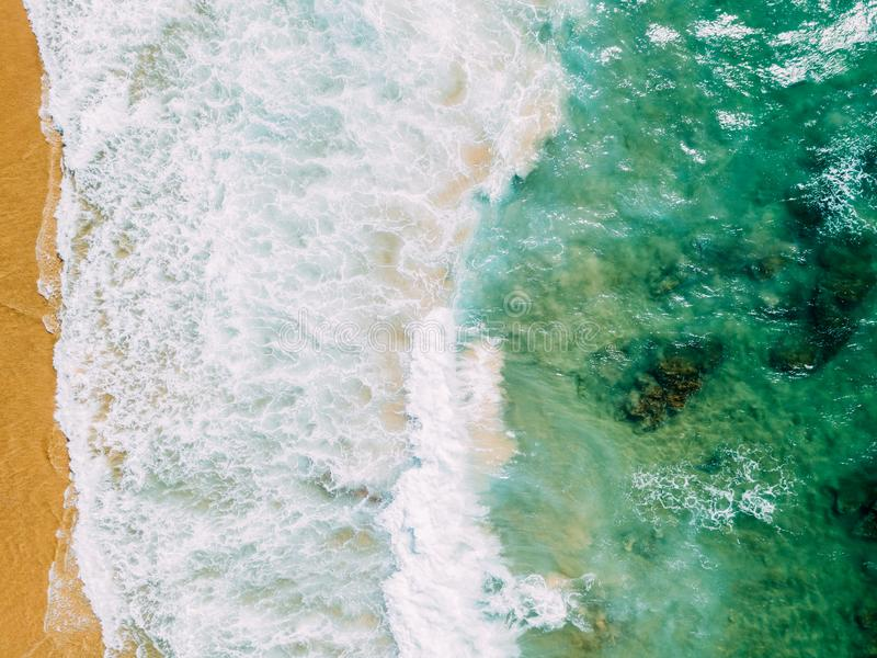 Aerial Panoramic Drone View Of Blue Ocean Waves Crushing On Sandy Beach royalty free stock photography