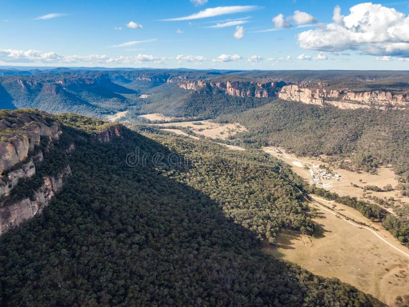 Aerial panoramic drone view of Wolgan Valley along the Wolgan River in the Lithgow Region of New South Wales, Australia. stock photos