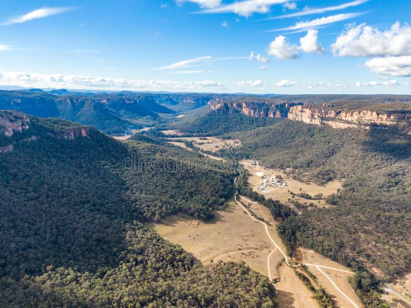 Aerial panoramic drone view of Wolgan Valley along the Wolgan River in the Lithgow Region of New South Wales, Australia. stock image