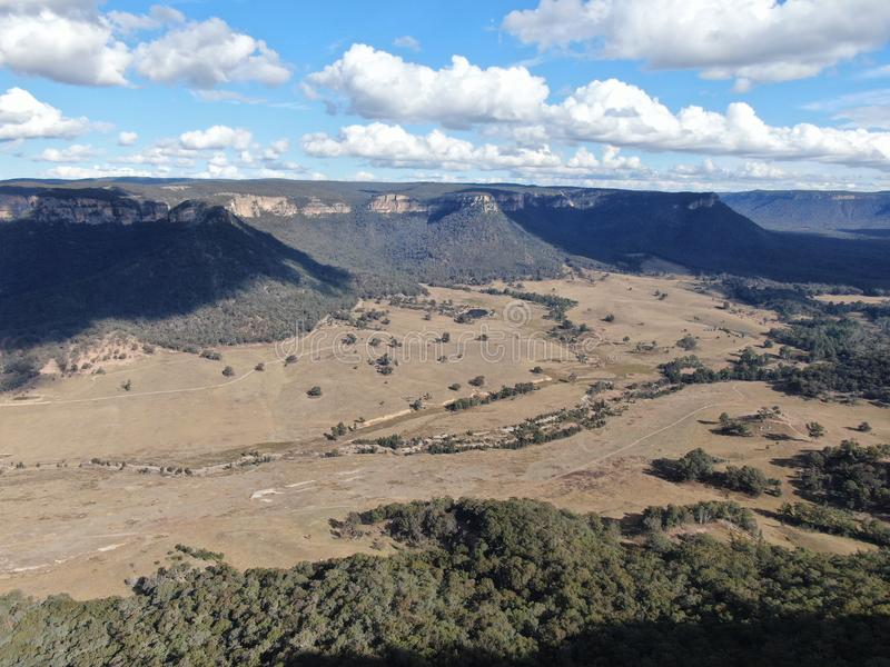 Aerial panoramic drone view of Wolgan Valley along the Wolgan River in the Lithgow Region of New South Wales, Australia. royalty free stock image