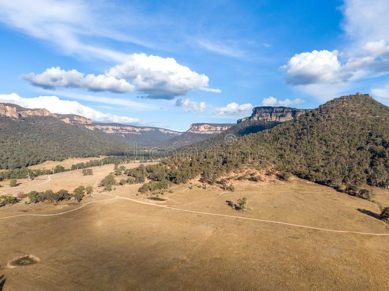Aerial panoramic drone view of Wolgan Valley along the Wolgan River in the Lithgow Region of New South Wales, Australia. stock photography
