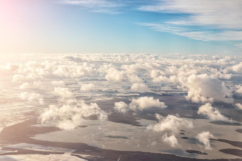 Aerial panoramic landscape view of earth with frozen lake and field. Cloudscape skyline photo from plane landing in austrian stock photos