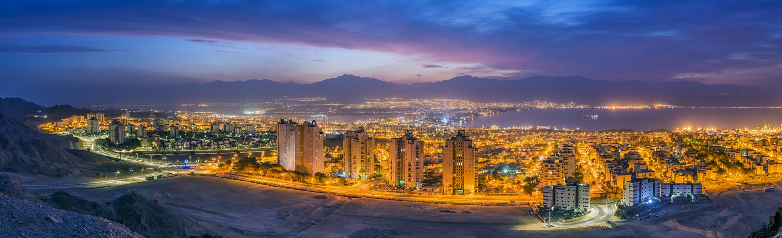 Aerial panoramic nocturnal view on Eilat Israel and Aqaba Jordan cities stock images