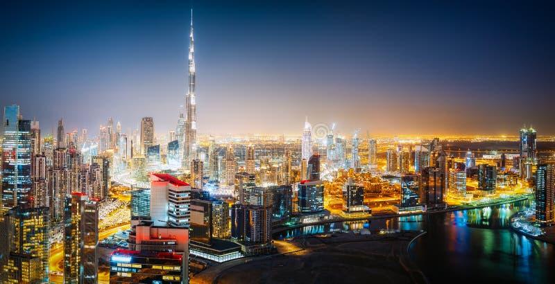 Aerial panoramic skyline of a big futuristic city by night. Business bay, Dubai stock photos