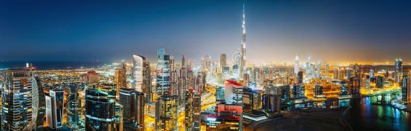 Aerial panoramic view of a big futuristic city by night. Business bay, Dubai, UAE. stock image