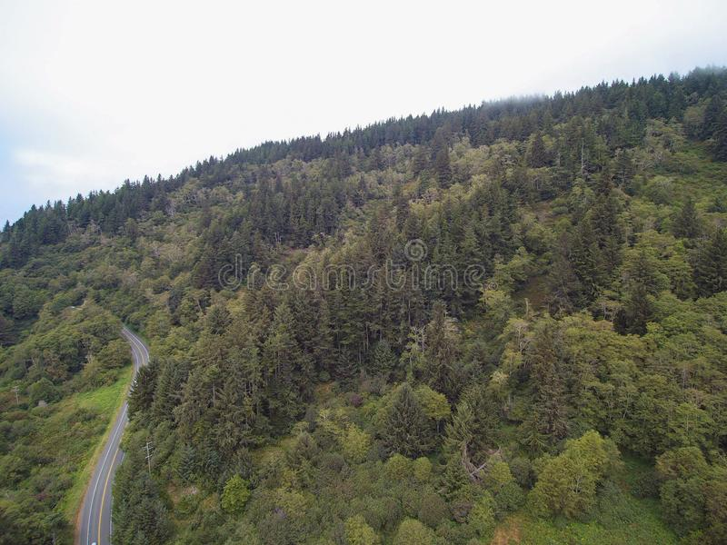 Aerial panoramic view of Mountain landscape with trees. Aerial panoramic view of forest Mountain valley with empty road stock photography
