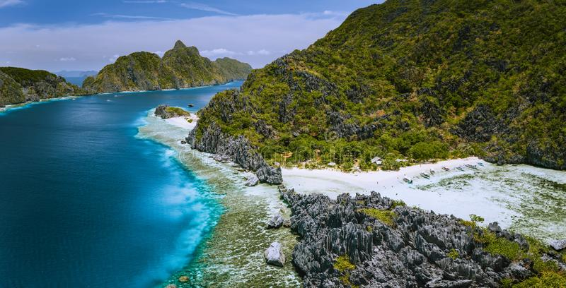 Aerial panoramic view of karst sharp cliffs of limestone island on adventures tour of El Nido, Palawan, Philippines.  royalty free stock photo