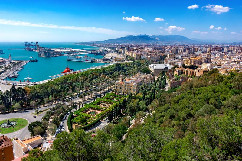 Aerial panoramic view of Malaga city, Andalusia, Spain in a beautiful summer day with the town hall the port and the sea. Aerial panoramic view of Malaga city stock photography