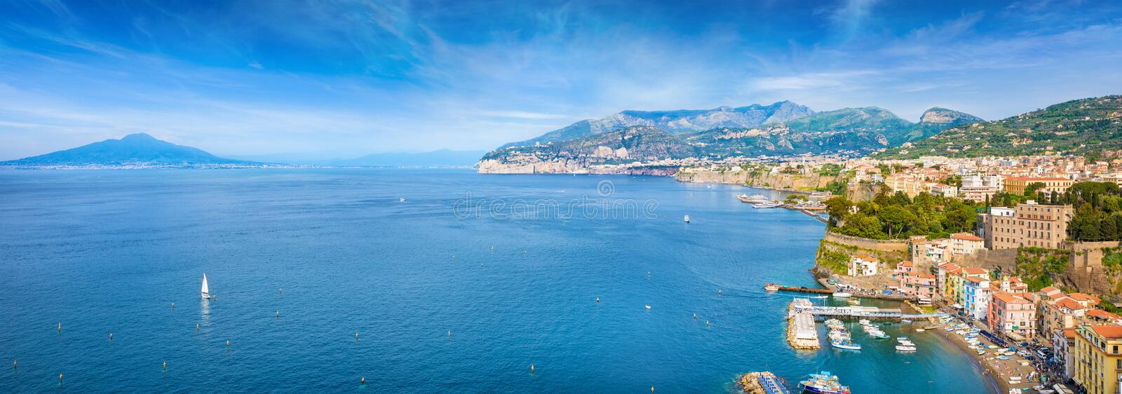 Aerial panoramic view of Marina Grande, cliff coastline Sorrento and Gulf of Naples, Italy. Sea cliffs and luxury hotels of Sorrento attract lot of tourists stock photography