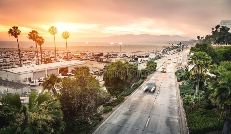 Aerial panoramic view of Ocean Ave freeway in Santa Monica beach. At sunset - City streets of Los Angeles and California state surrounds - Warm twilight color stock photos