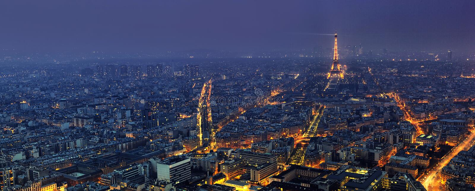 Aerial panoramic view of Paris at night from Tour Montparnasse stock images