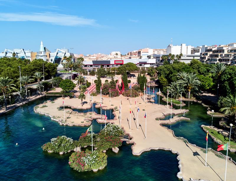 Aerial panoramic view pond, shape of the European continent in the Park of Nations and Torrevieja cityscape stock photo