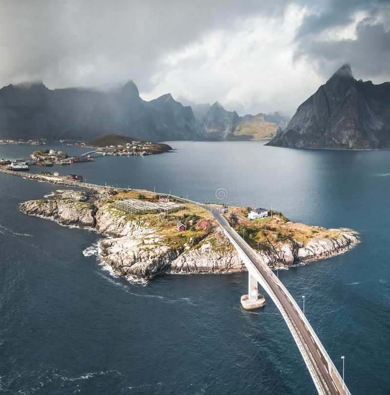 Aerial panoramic view of Reine traditional fishing village in the Lofoten archipelago in northen Norway with blue sea royalty free stock image