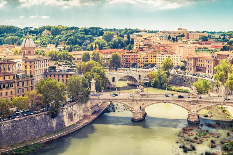 Aerial panoramic view of Rome in summer, Italy. Tiber River with bridges in Rome on a sunny day. Rome skyline. Beautiful scenic panorama of Rome in the royalty free stock images