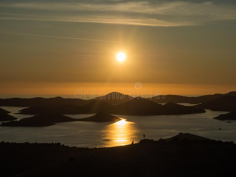 Aerial panoramic view of sunset above the islands in Croatia with many sailing yachts between, duak in Kornati national park lands stock photography