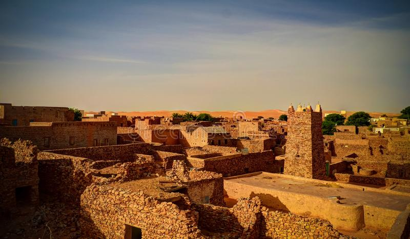 Aerial panoramic view to Chinguetti mosque, one of the symbols of Mauritania. Aerial panoramic view to Chinguetti mosque, symbols of Mauritania stock images