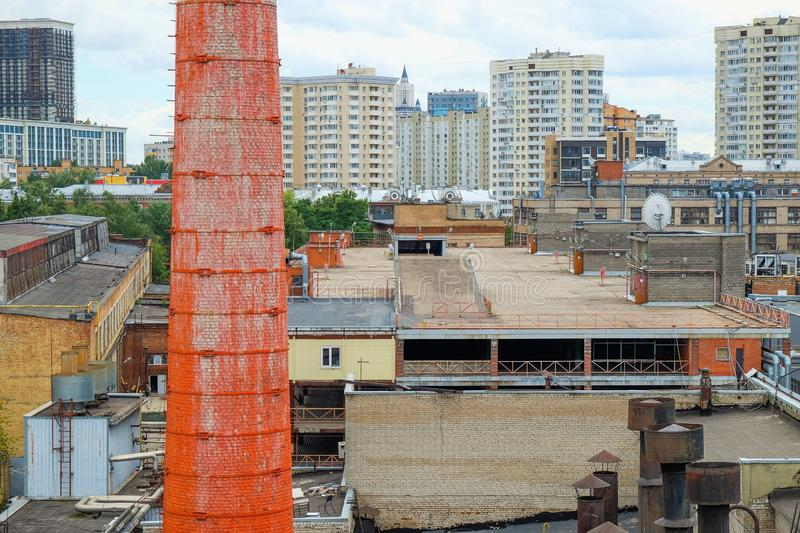 Aerial panoramic view to historic red brick pipe and old industrial storage buildings with new modern urban architecture on backgr stock photo
