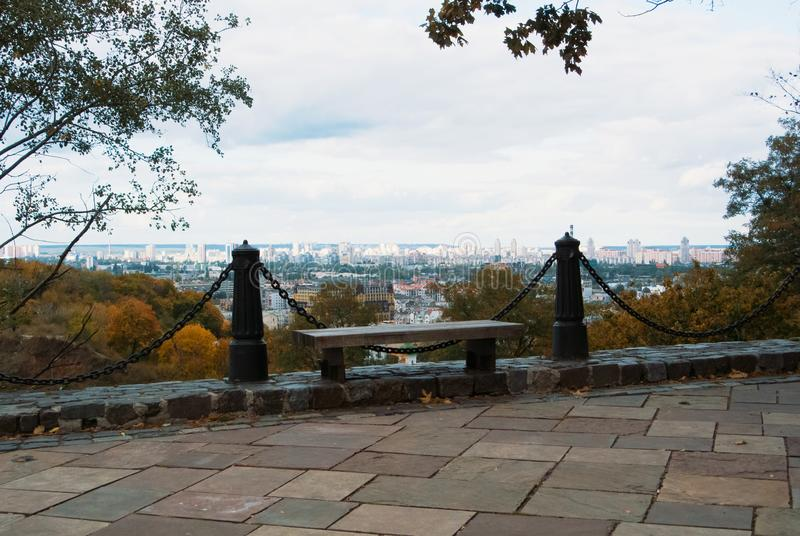 Aerial panoramic view to Kyiv with a bench at the foreground on stock images