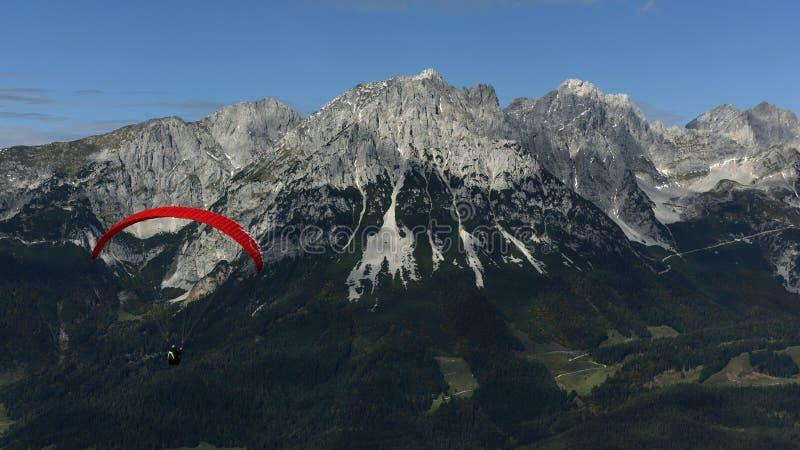 Paragliding around Wilder Kaiser, Tirol, Austria. Aerial paragliding view on Wilder Kaiser mountains in Tirol - Austria royalty free stock photo