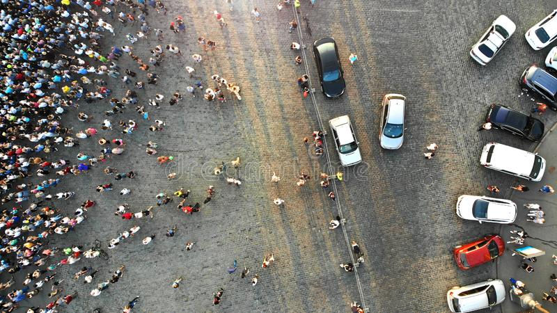 Aerial. Parking lot with cars and people crowd. Crowded city square. Top view.  royalty free stock image