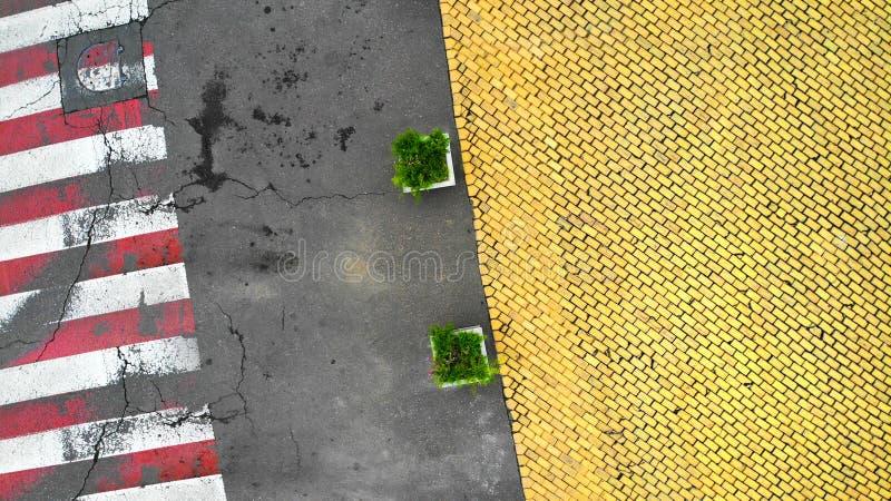 Aerial. Pedestrian crosswalk on asphalt road and yellow paving stone. stock image