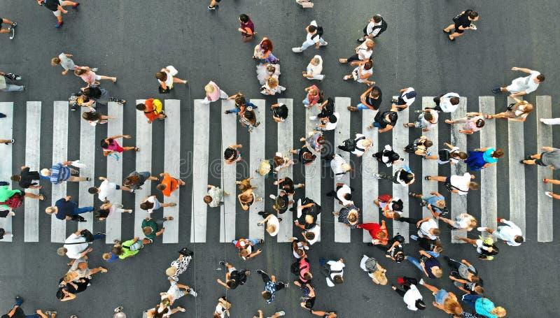Aerial. People crowd on pedestrian crosswalk. Top view background.  royalty free stock image