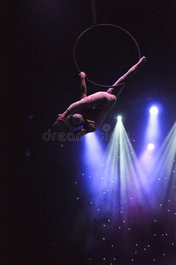 Aerial performer. Aerialist performer Fallon Deliseo performing aerial act on board cruise ship Celebrity Reflection stock photography