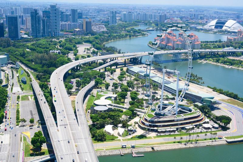 Singapore Flyer, aerial view of Marina Reservoir and Marina Bay with big wheel, park, junction  and luxury buildings in background stock photo