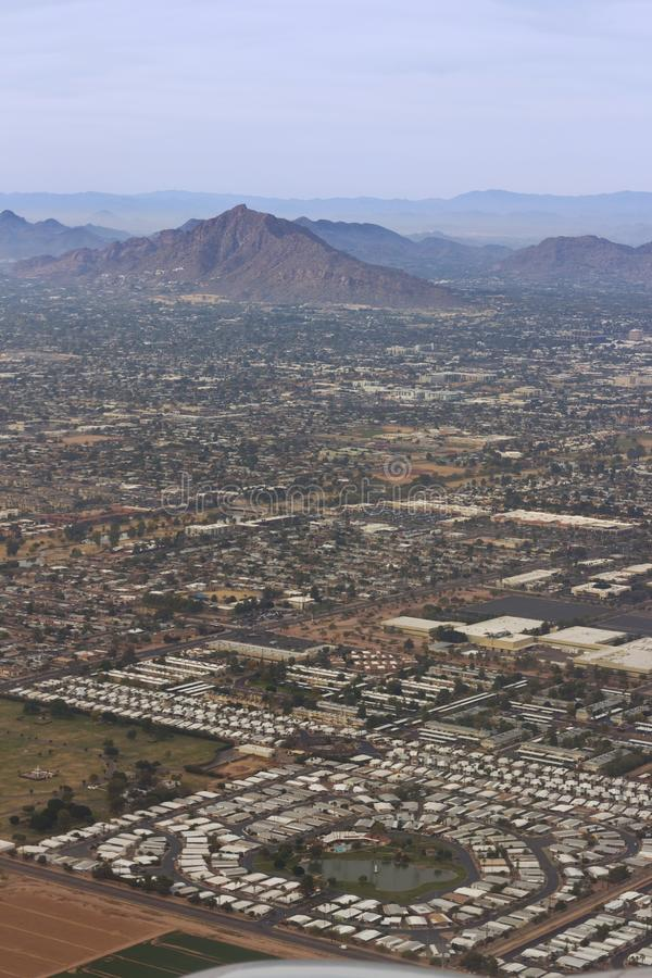 Aerial of Phoenix, Arizona Neighborhood. An aerial view of a suburbian neighborhood with the Camelback Mountain in Phoenix, Arizona royalty free stock photography