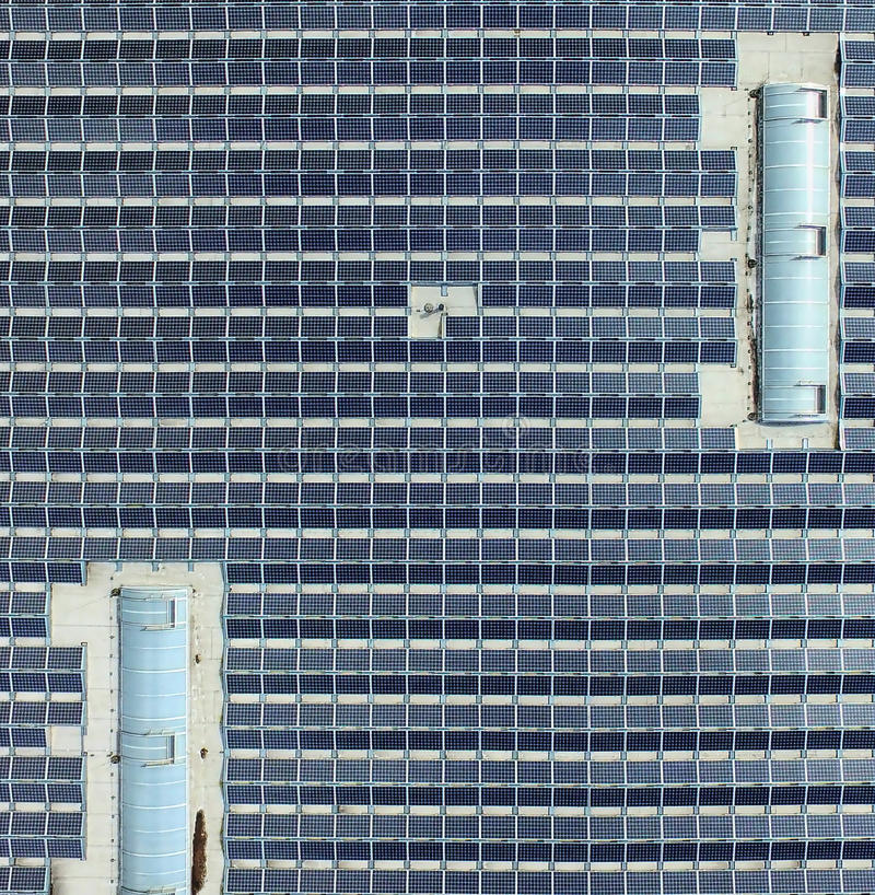 Aerial photo of a big hall badger with solar modules, detailed view from the bird`s-eye view royalty free stock image