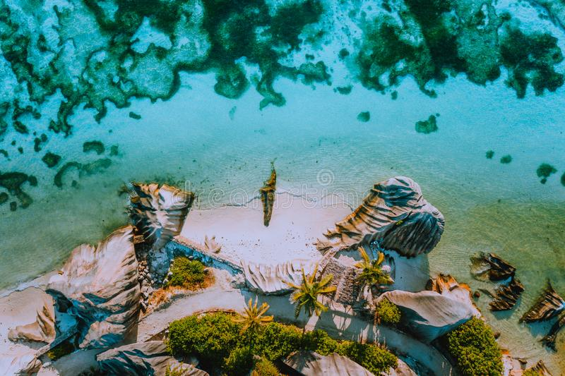 Aerial photo of coastline shape of beautiful famous paradise tropical beach Anse Source D Argent at La Digue island stock photography