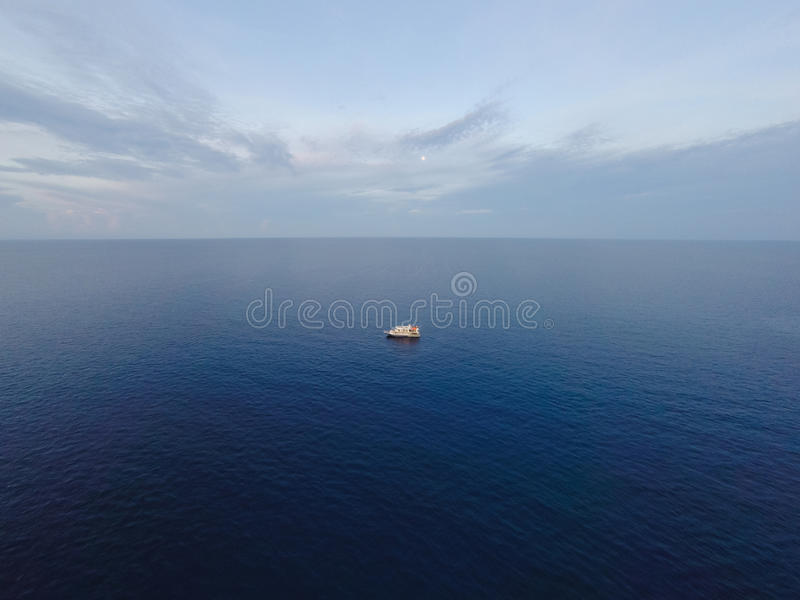 Aerial photo from flying drone of a fascinating nature landscape with dramatic evening sunset sky which reflected in sea water. stock photography