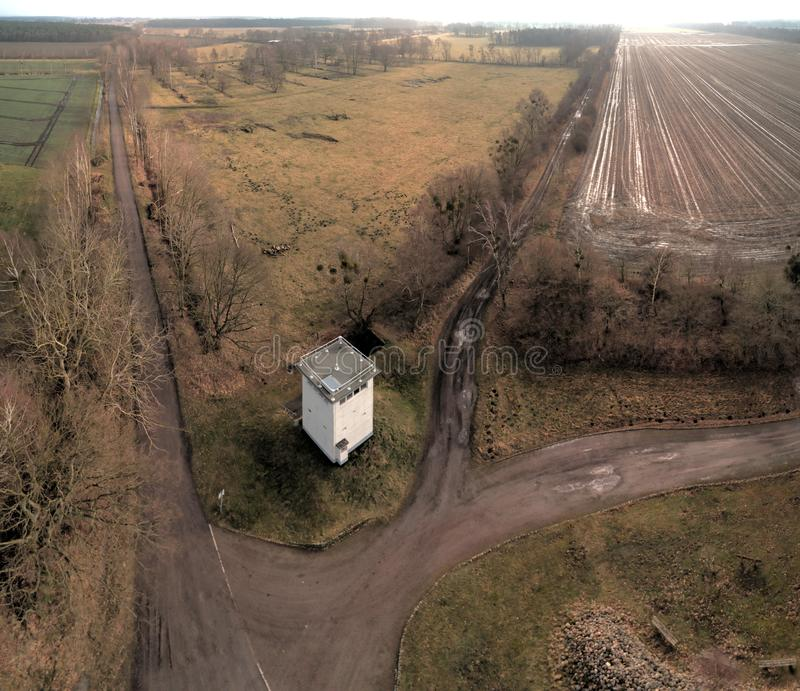Aerial photo of a former watchtower at the border fortifications between the GDR and the FRG. Open-air exhibition in a forest near royalty free stock images