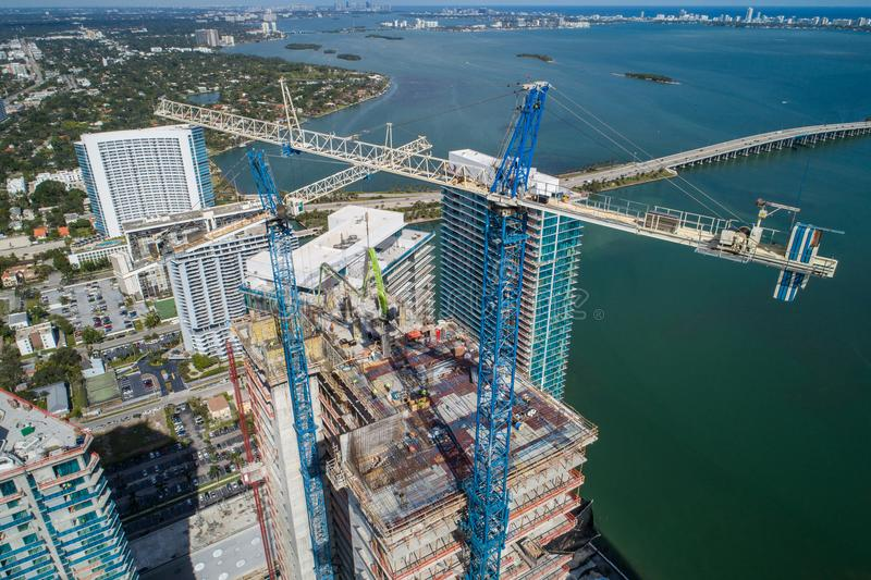 Highrise architecture under construction with cranes aerial image stock images
