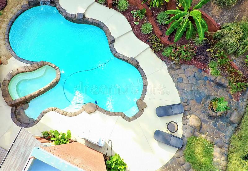 An Aerial Photo Of A Lagoon Swimming Pool And Rock Deck ...