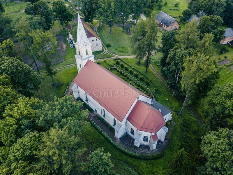 Aerial Photo of an Old Lutheran Church in Countryside Between Trees in Early Spring on Sunny Day, Close up stock images